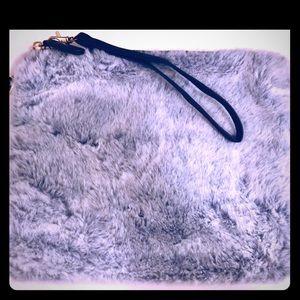 Furry blue clutch